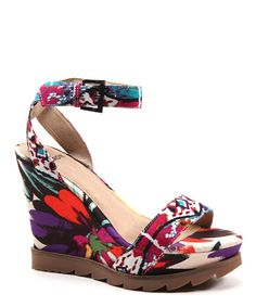 Thrill-seeking feet will flock to these sensational shoes! A buckled ankle strap secures the top, while a floral burst of multicolor blossoms across the wedge and toe.3.5'' heelwith 2'' platformBuckle closureFabric upperRubber outsole
