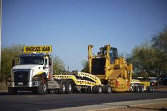 Heavy Haul Cat tractor and a CAT CT660 under way.