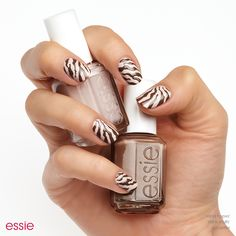 Show your true stripes this Halloween in this fierce feline nail art look that is pur-fection. Meowww. Get this catty look using essie 'sand tropez' a soft sandy beige nail polish and 'mink muffs' a smoky plush taupe.