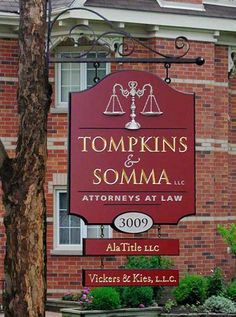 Tompkins & Somma Law Office Sign, in Birmingham, Alabama. Carved & gilded text, hand-sculpted & artist-painted scales of justice add-on. See more of our work on www.danthoniadesigns.com