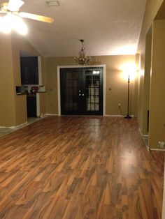 Laminate floor dark doors and trim along with brown walls classy look  for Cheap remodel tips for flipping homes