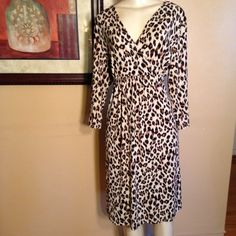 "Chico's Dress Gorgeous leopard print dress, faux wrap in a soft stretchy fabric. No lining no zippers and no buttons. Chico's uses its own unique sizing chart. This is a Chico's size 3 which is a regular size 16. Measurements are 42"" long, 22"" bust, 20"" waist, 24"" hips.  In good condition. Bundle and save.  Sorry no trades and no holds.  Please use offer to negotiate,  all reasonable offers considered.  Please no low balling. Chico's Dresses"