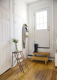 White walls. Hunter boots. Stripes.