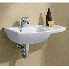 another tiny wall mount sink over $200 but with this one you get  miniscule little counter space in case you own a toothbrush.  Faucet is awful.