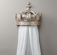 create a bedchamber fit for a princess with a wall-mounted crown and built-in drapery.