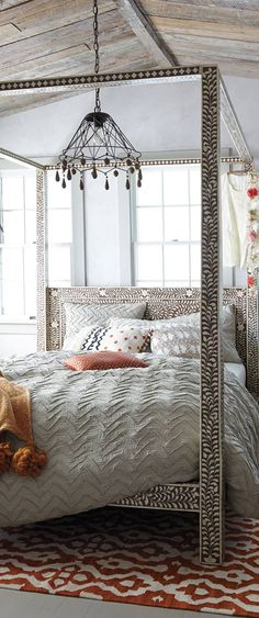 It's anthropology so I'm sure it's a gazillion dollars but I am in love with this bed frame...