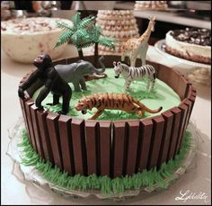 Zoo/jungle cake with kitkat lengths and toy animals