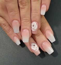 Beautiful white and nude gradient nail art. This style looks very neat and clean. Make it stand out by adding white flower embellishments on top with silver beads.
