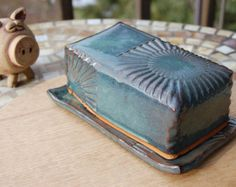 Adorn your kitchen table with this gorgeous handmade pottery covered butter dish. The texture and the depth of color on this slate blue covered butter dish is just fabulous. Handmade pottery butter dish made in Burnsville North Carolina Hand Built Pottery, Wheel Thrown Pottery, Slab Pottery, Ceramic Pottery, Ceramic Art, Slab Boxes, Ceramic Butter Dish, Amish Butter, Salt Pig