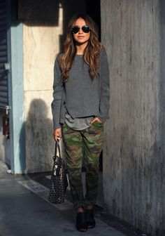 camo pants and grey sweater