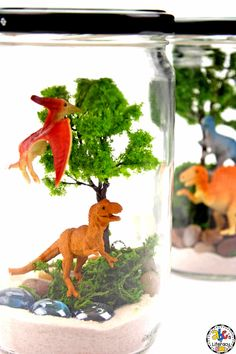 Are you looking for an easy-to-make and creative Dinosaur activity? Your kids are sure to love creating this fun Dinosaur Terrarium while they are learning all about dinosaurs. This craft looks difficult but it is so simple to make. Kids can create their unique Pre-Historic Animal terrarium to look however they want too. It can also be a fun night light and adorable keepsake too! Click on the picture to learn how to make this Dinosaur craft? #dinosaurcraft #dinosaurunit #dinosauractivity