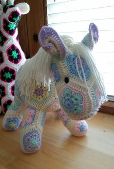 Pastel pony made up of African flower motifs, pattern by Heidi Bears