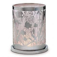"Enchanted Coral Votive Hurricane. Undersea enchantment! Intricate aquatic scene mesmerizes with candlelight sparkle. Photo-etched metal hurricane lined with light-diffusing mesh. Includes glass cup for tealights and votives, sold separately. 6¾""h; 5¾""w."