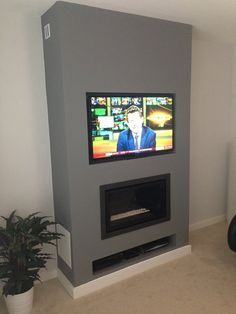 GAZCO STUDIO 1 GAS FIRE WITH TV ABOVE- BALANCED FLUE. WE BUILT A FALSE BREAST WITH RECESSES FOR THE FIRE, TV AND SYSTEMS BOXES.