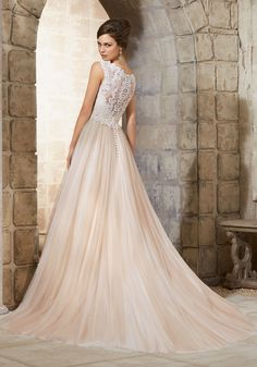 Morilee 5368: Simplistic elegance is found in this stunning Bridal Ball Dress. Accented with a delicate lace V-neck bodice. Colors available: White and Ivory, Ivory/Nude