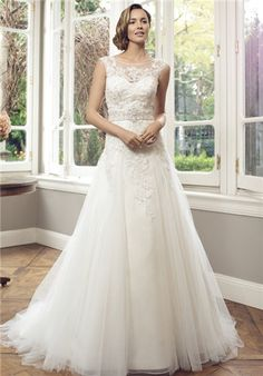 Soft A-line tulle gown with sweetheart neckline and lace applique // M1410Z from Mia Solano