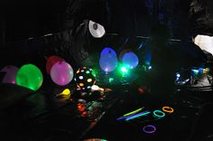 OH HOLY FUN!!!! We're so doing this! A Tarp black room filled with GLOW STICKS and balloons!