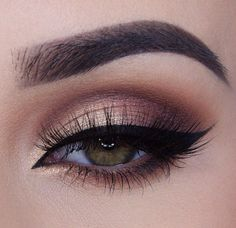 Beautiful smokey eye with perfect winged liner.