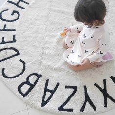 From A to Z and every letter in between, a round rug gives your nursery such a soft touch. Dimensions & Details: - 5 feet in diameter - Individually handmade, making each rug unique - Minor variations