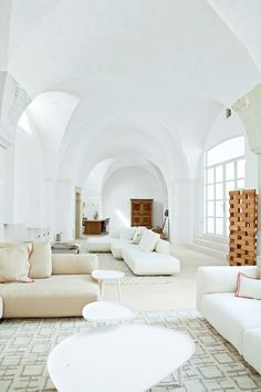 Look at that ceiling! I would use color to show it off though - make the architectural details pop!