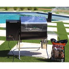 Get the best out of wood pellet cooking with our choice of the best wood pellet smokers of Including grills from Traeger, Pit Boss, Camp Chef, and more. Best Bbq Smokers, Best Smoker, Electric Bbq Grill, Green Mountain Grills, Charcoal Smoker, Wood Pellet Grills, Wood Pellets, Tailgating, Grilling