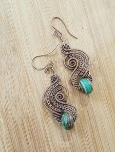 Check out this item in my Etsy shop https://www.etsy.com/ca/listing/251206211/wire-wrapped-earrings-mint-chocolate