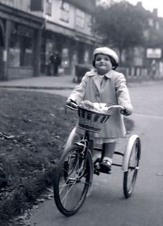 ~~In Cheam Village on a tricycle~~