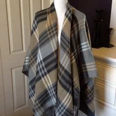 Plaid Blanket Poncho Gorgeous grey, Black and Tan plaid poncho. Fringed bottom. Charcoal grey on inside so can be reversed if tag is cut. Sweaters Shrugs & Ponchos