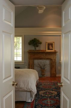 Love the look of a fireplace in your Master Suite, but have no space or  budget for it? An old mantel and a bit of creative license is all you need for a faux fireplace - if you prefer a more 'real' look, paint the wall black to mimic the firebox, and cover it with a fire-screen...