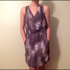 Banana Republic Dress Banana Republic Dress, 100% silk, grey slate print, cross-chest v neck, elastic waist, off-white poly slip, two pockets in the front, gently worn Banana Republic Dresses