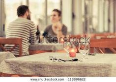 Romantic Young Couple at Restaurant by William Perugini, via ShutterStock
