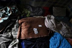 The bed of Hosam, a migrant living in the camp known as 'The Jungle' who died after hitting his head in the Channel Tunnel, while making his way to England to seek asylum there and make a better life. Photographed on 11th August 2015.