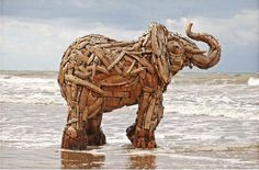 Elephant Sculptures made from driftwood by South African artist Andries Botha via whatthecool