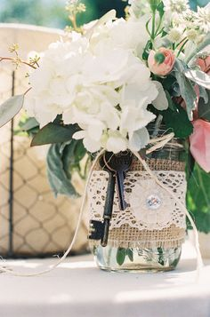 Cute centerpiece for rustic wedding - love the burlap and lace