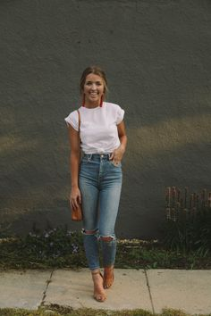 White tee, jeans, sandles, statement earrings