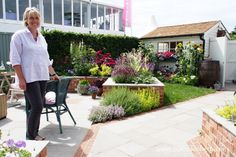 Garden designer, Tracy Foster, in the garden she designed for Just Retirement: A Garden For Every Retiree, at the RHS Hampton Court Palace Flower Show 2015.
