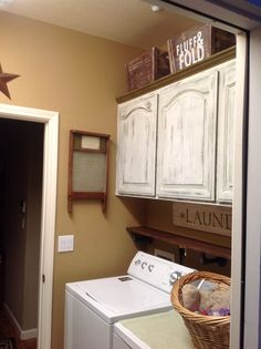 Chalk painted cabinets (green over white), caramel walls, old fence boards for the sign & shelf with black iron fittings for brackets. Chalk Paint Cabinets, Painting Cabinets, Mud Rooms, Laundry Rooms, Green Cabinets, Kitchen Cabinets, Old Fence Boards, Old Fences, Decor Ideas