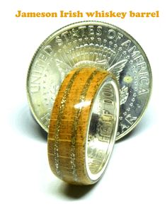 Silver half dollar wedding ring with Jameson Irish whiskey barrel wood Wooden Wedding Bands, Jameson Irish Whiskey, White Oak Wood, Coin Ring, Dollar Coin, Wood Rings, Half Dollar, Unique Colors, Handmade Wooden