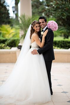 The bride wore a stunning ball gown with a long veil and bright pink bouquet. Photography: Kristen Weaver Photography. #WeddingDress Read More: http://www.insideweddings.com/weddings/gold-white-wedding-with-brazilian-indian-flair-in-orlando-fl/647/