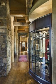 Love the wine cellar's curved glass wall