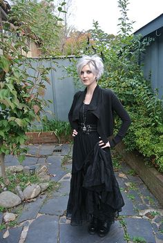 gorgeous all-black outfit. Her silver hair is lovely too.