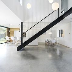 Architecture, Divine Contemporary Runners House By Ar Design Featuring Black Staircase Concrete Floor White Dining Set Pendant Lamp Minimalist Kitchen In White Interior Idea: Contemporary Traditional Home Design with Unique Combination Black Staircase, Staircase Design, Design Studio, House Design, White Dining Set, Escalier Design, London House, English House, House Extensions