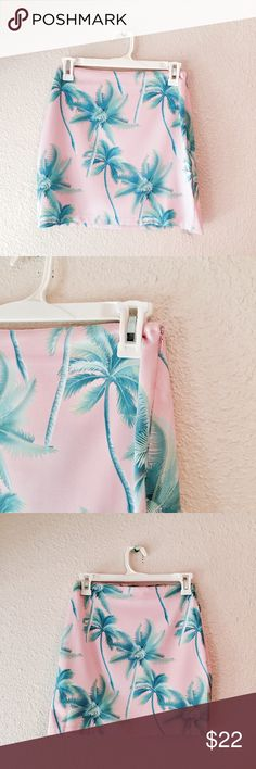 TOBI palm tree silky mini skirt pink green small Amazing mini skirt from Tobi! Light blush pink with a palm tree print across it. Silky smooth material. Zip and hook closure. Excellent used condition. Size small. Tobi Skirts Mini