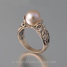 "The ""Enchanted Pearl"" ring : rose gold with a pink pearl.Inspired by the Renaissance art, this breathtaking ring was designed by the artist and jewelry designer Sergey Zhiboedov. Gold Pearl Ring, 14k Gold Ring, Pearl Jewelry, Gold Jewelry, Jewelry Rings, Fine Jewelry, Pearl Rose, Jewellery, Rosa Ring"