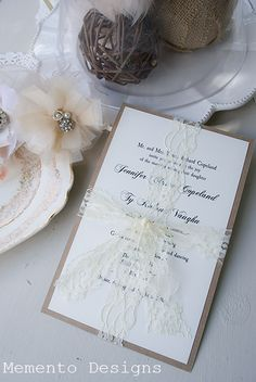 I'm making the invitations myself, and I think I might could pull this look off by myself with the right supplies.  Probably just a single horizontal strip of lace or a nice ribbon instead, though.