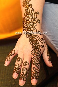 Henna with flowers trailing on top of the hand. Perfect for mehndi party or a girls night out