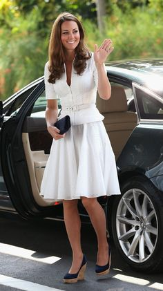 Kate Middleton waved as she got out of the car at the Gardens by the Bay in Singapore.  She donned a white Alexander McQueen suit . 09/12/2012