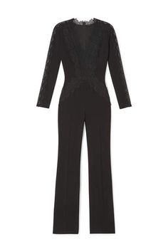 WILLOW JUMPSUIT IN FLUID CREPE: A sleek fluid crepe jumpsuit with flared pants and a plunging neckline, floral lace gives a feminine touch across the bodice and along the sleeves.