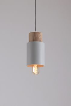 Pendant lamp with metal construction, decorative wooden cylinder and textile wires are presented in a variety color combinations and hints. Pendant Chandelier, Pendant Lighting, Pebble Grey, Luminaire Design, Photo On Wood, Furniture Inspiration, Bulb, Ceiling Lights