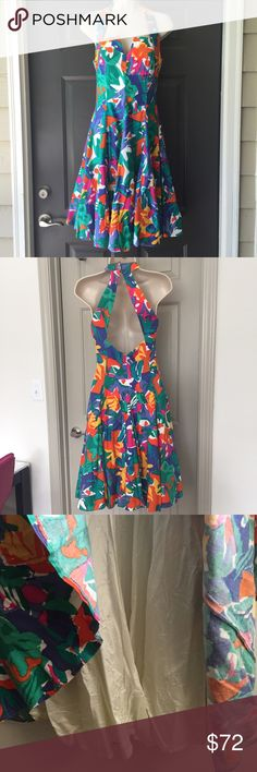 A.J. BARI Vintage Floral Multicolored Halter Dress So sad this doesn't fit me 😩! Bust is approximately 15 inches across laying flat. Waist is approximately 14 inches across laying flat. Total length is approximately 41 inches. The hooks around the neck are a little loose but still attached (shown in 4th picture). Zips in the back. Fit & flare style. A.J. Bari Dresses